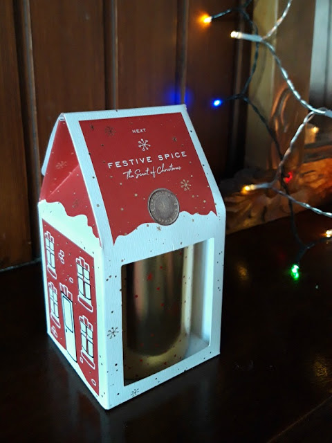A photo of a NEXT Festive Spice Candle in a box