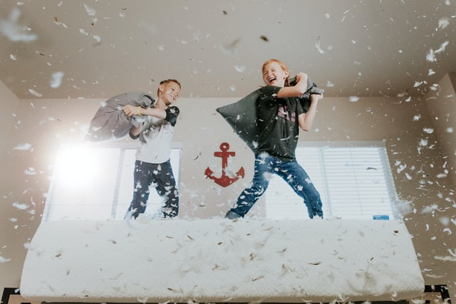 two boys in a pillow fight