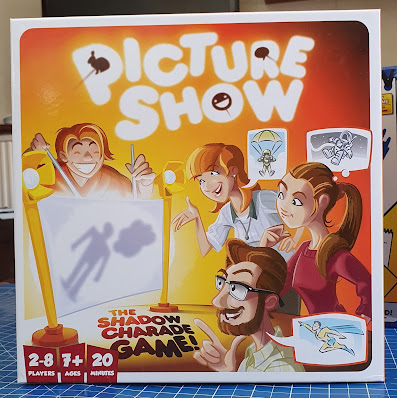 Picture Show Shadow Charade Game box front with illustration of gameplay and smiley people