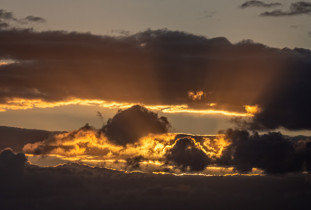 Photo of golden-edged clouds over the Solway