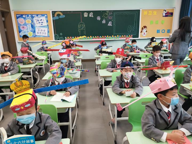 COVID-19: School in China return to classroom with the help of 'social distancing hats'