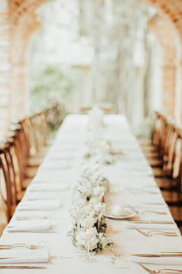 simple white reception centerpiece and tables