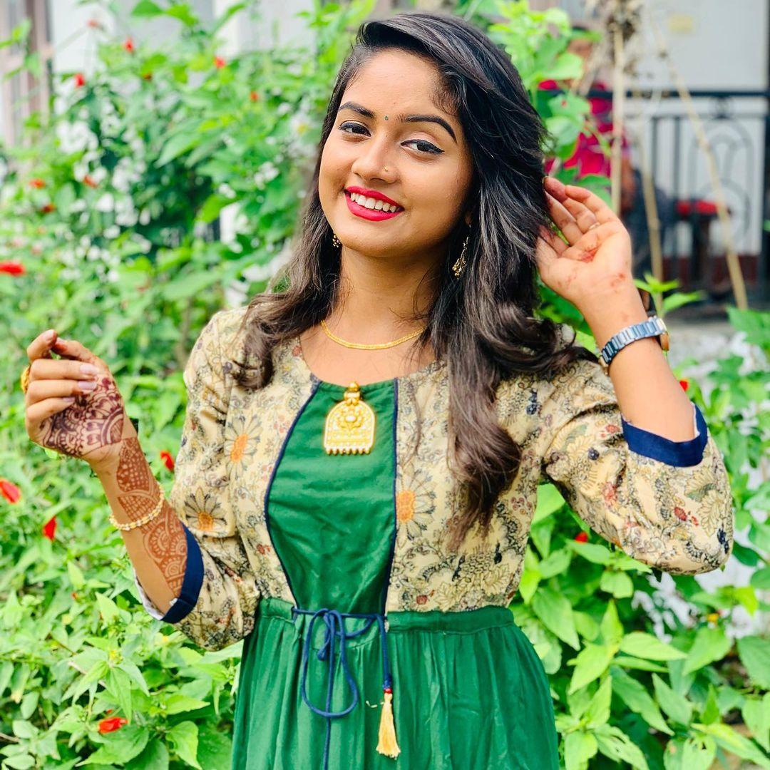 Nisha Guragain in Green Suit Photos  Images Download