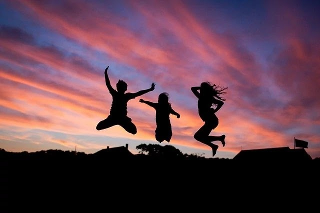 three friends jump
