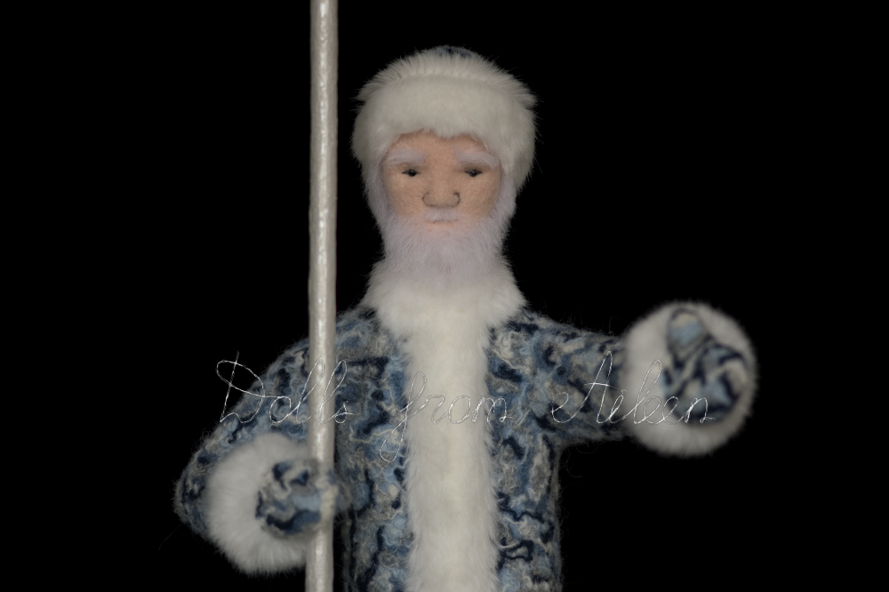 OOAK needle felted Father Frost doll looking into the camera