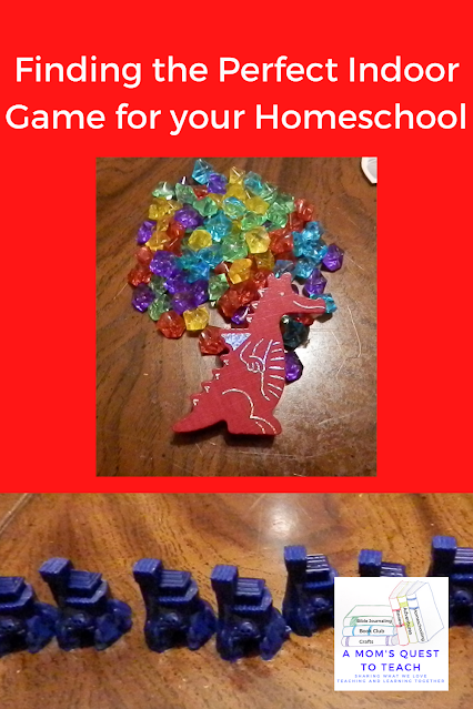 A Mom's Quest to Teach logo; blue pieces from Catan Junior; Dragon breath dragon and gems; Finding the Perfect Indoor Game for your Homeschool