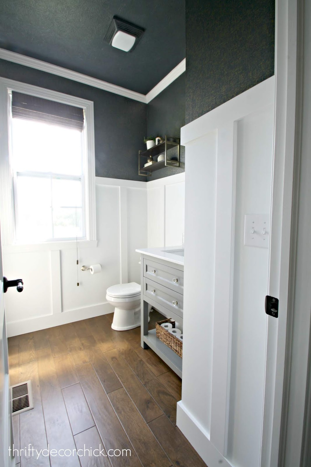 Dark navy and white board and batten bathroom