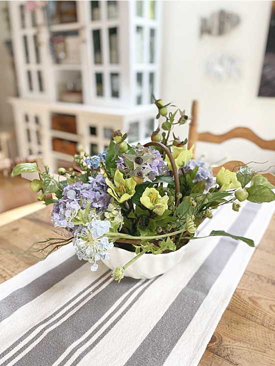 Nearly natural centerpiece in kitchen with hutch in background