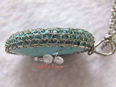 Side view of a large viking knitted turquoise pendant