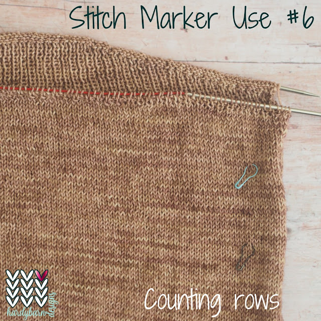 Coffee-coloured hand knit top with markers in fabric