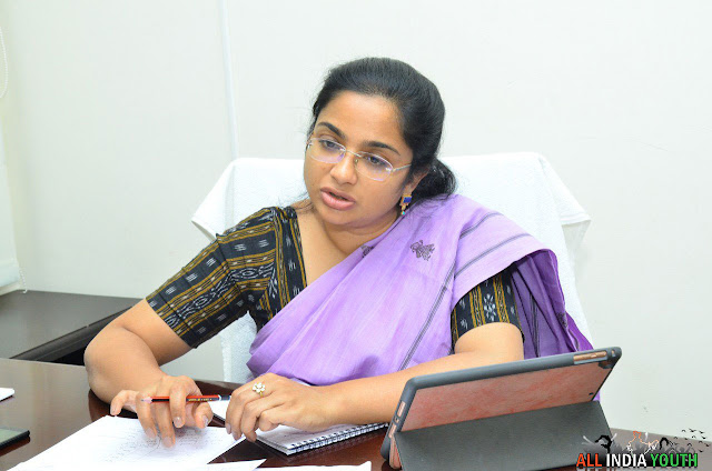 Swetha Mohanty Wanaparthy District Collector with her Tab in the office