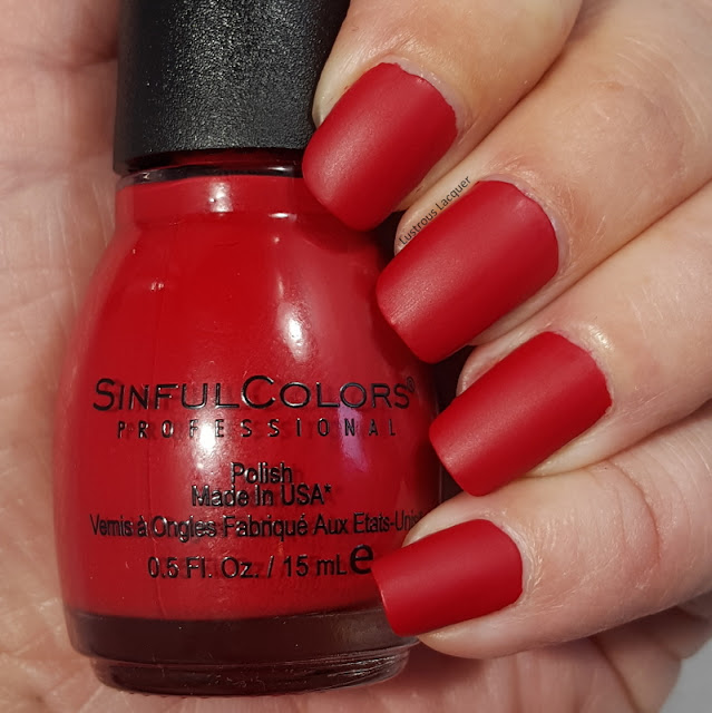 Bright red colored nail polish with a matte finish