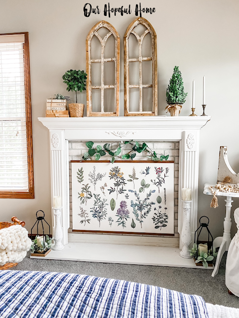 master bedroom faux fireplace hanging botanical print poster decor