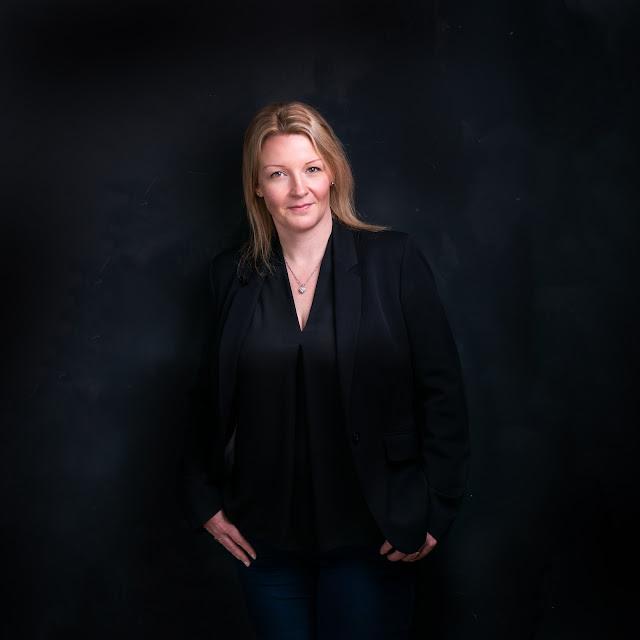 Stephanie in black suit jacket