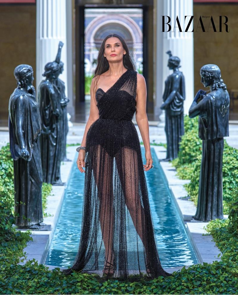 Demi Moore wears Dior Haute Couture dress and Sergio Rossi sandals