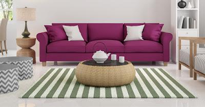 Las alfombras con formas, rayas, color dan vida a un espacio monocromático.