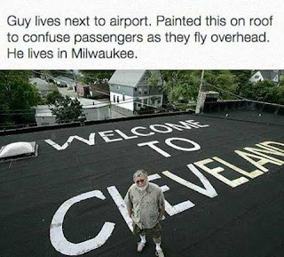 """Guy lives next to airport. Painted """"Welcome to Cleveland"""" on roof to confuse passengers flying overhead. Lives in Milwaukee."""