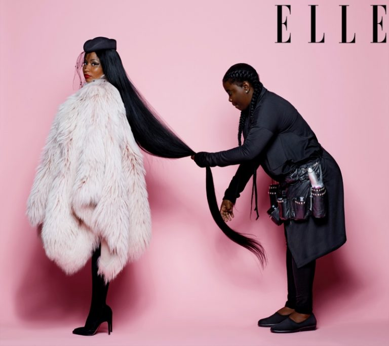 Rapper Nicki Minaj poses in Nini Ricci fur coat and veil hat with Stuart Weitzman pumps