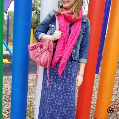 awayfromtheblue Instagram | navy printed maxi dress with denim jacket pink accessories scarf and balenciaga day bag
