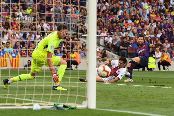 Lionel Messi of FC Barcelona scores his team's first goal during the La Liga match between FC Barcelona and SD Huesca at Camp Nou on September 2, 2018 in Barcelona, Spain.
