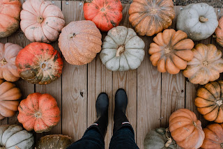 loads of pumpkins on floor around feet