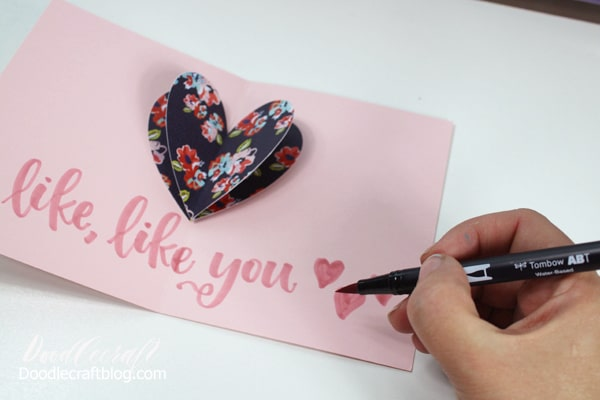 Make a simple pop up card with 3 hearts, folded cardstock and Tombow Adhesive