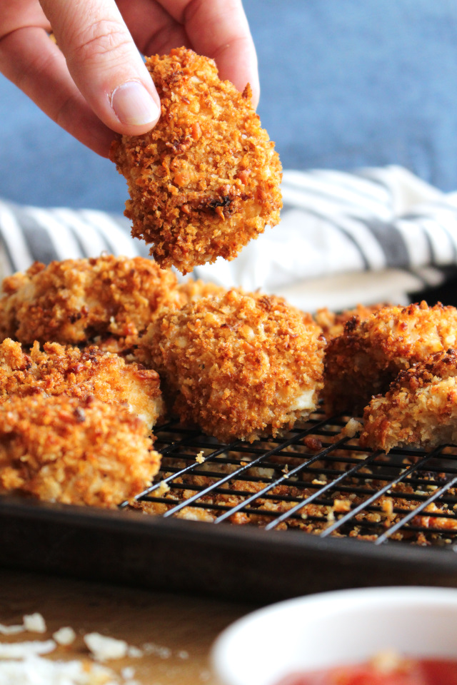 Crispy Parmesan Ranch Chicken Nuggets are dipped in ranch dressing, coated in a parmesan cheese and panko, and then baked in the oven for just 10 minutes until they are golden brown and extra crispy!