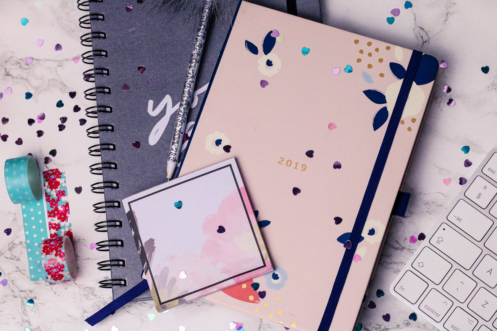 flaylay photo of a 2019 diary and a notebook on a desk with washi tape and a pen