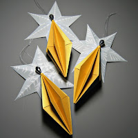 Origami Diamond Ornaments on Folded Stars