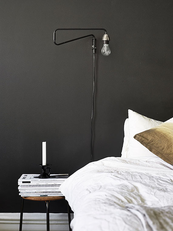 Bedroom with black accent wall | Jonas Berg