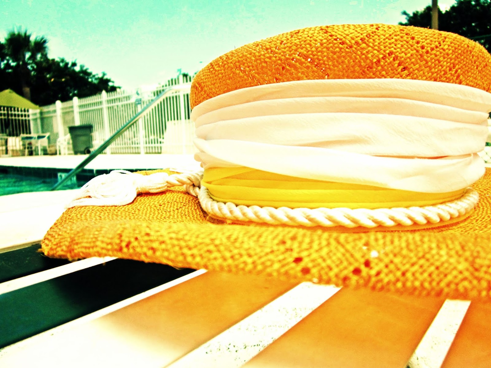 A vintage yellow sunhat by the swimming pool in Florida