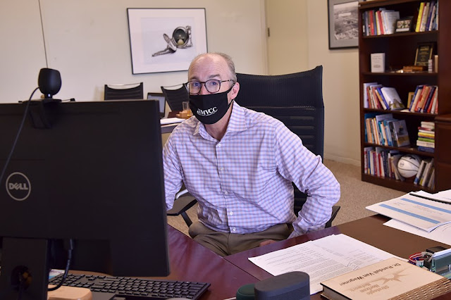 MVCC President Randall VanWagoner wears a face covering while he works in his office