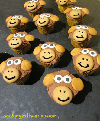 banana cupcakes with chocolate frosting, nilla wafers to make monkey nose, mouth and ears and candy eyes