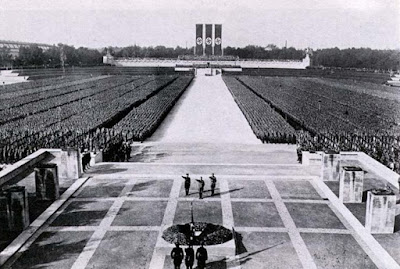 political religion Nazi secularization sacralization higher cause fascism fanaticism