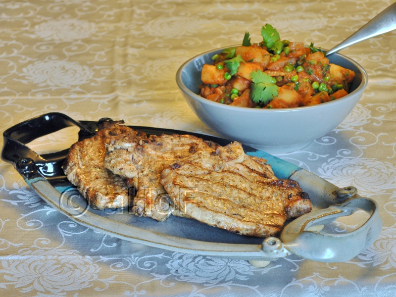Pork Chops in Indian Spices and Potato Pea Curry