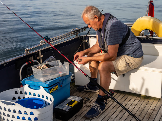 Photo of Phil baiting a hook