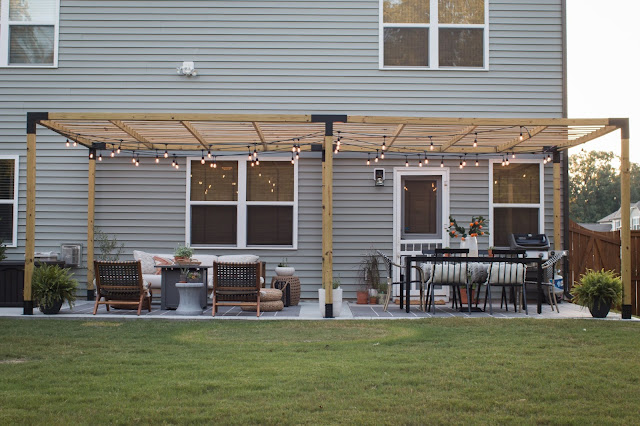 Outdoor Pergola with a Dining area and lounging area