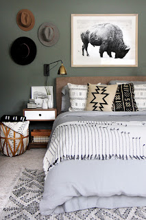 bohemian bedroom with styled hat wall