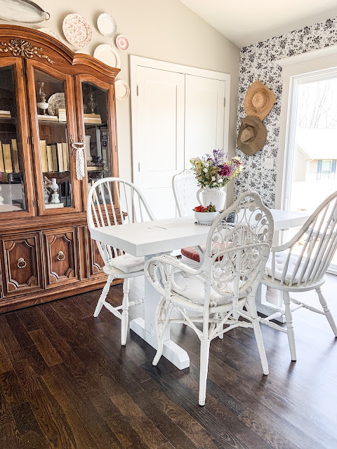 white farmhouse table with mismatched chairs