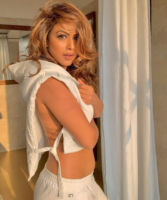 nia sharma hot pics in open white jacket gets brutally trolled