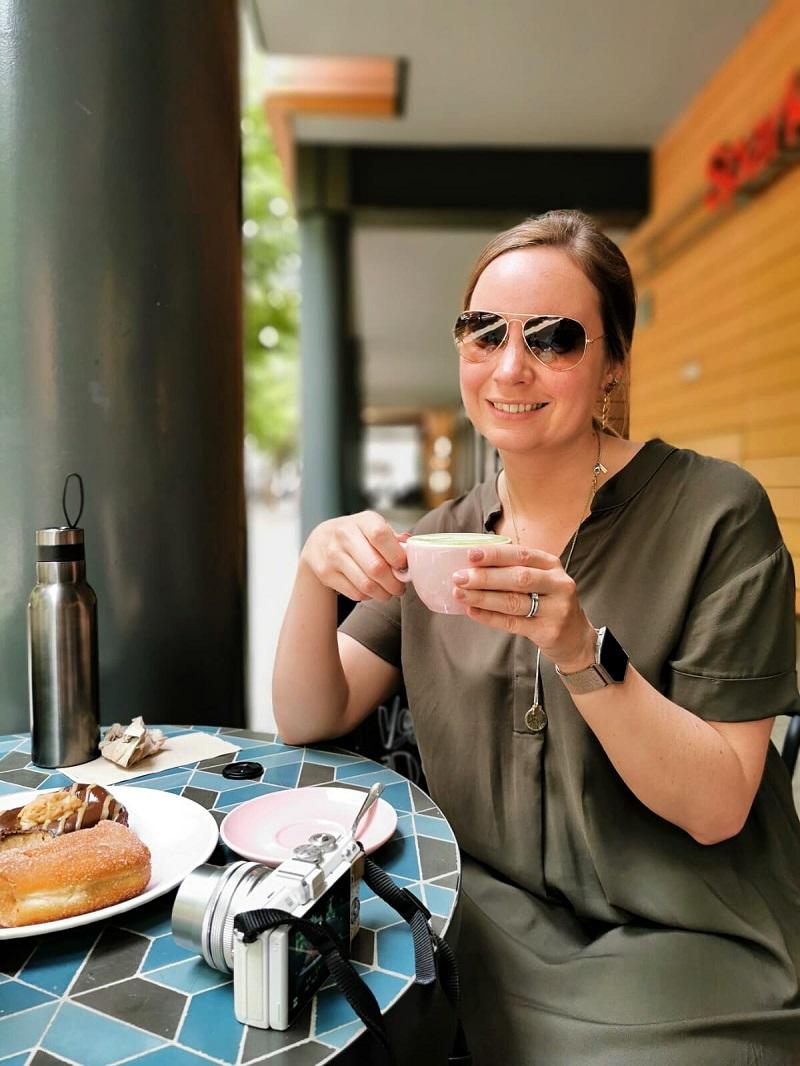 Me sipping a matcha latte at Brammibals Donuts