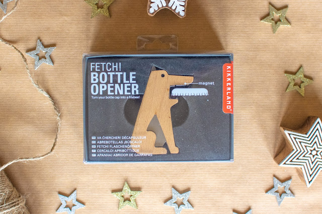Fetch Dog Shaped Bottle Opener in box showing that it holds the bottle lid like a frisbee.  A great gift for dog lovers