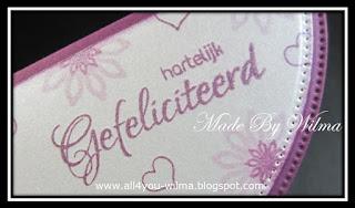 """Close-up van """"hartelijk Gefeliciteerd"""" en enkele clearstempeltjes. Close-up of """"Congratulations"""" (Dutch words) and some clearstamps."""