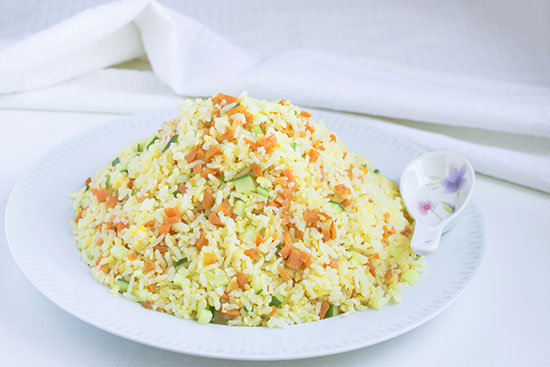 Chinese food - Riced fried with carrots, eggs and cucumber