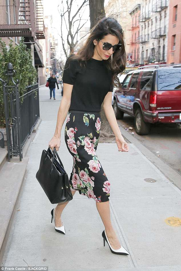 Amal stepped out in New York City this week looking super chic in a black short sleeve sweater and floral skirt