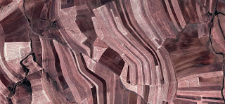 abstract expressionism,abstract photograph of the Spain fields from the air, which mimic an abstract painting