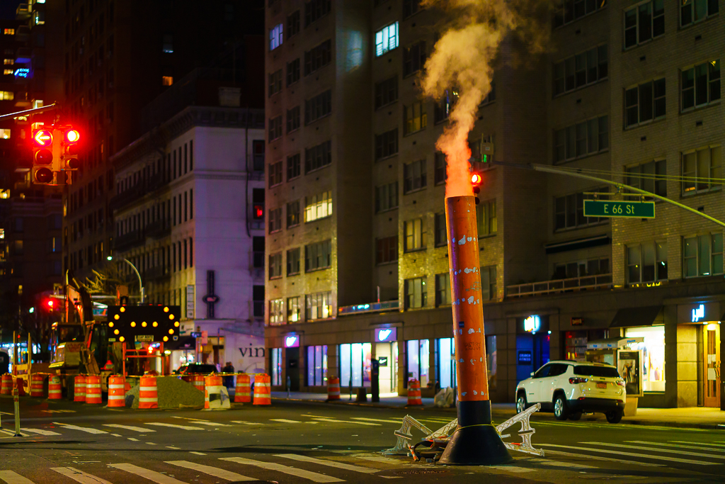 a photo of a steam pipe in new york city at night