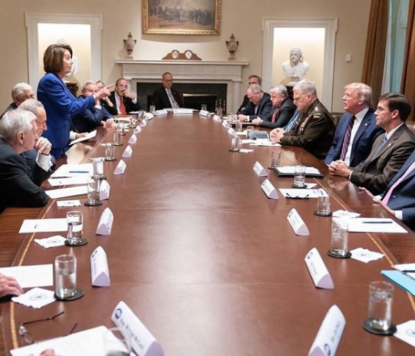 "Nancy Pelosi stands with her finger pointed at President Trump during a meeting where the president reportedly ""had a meltdown"""