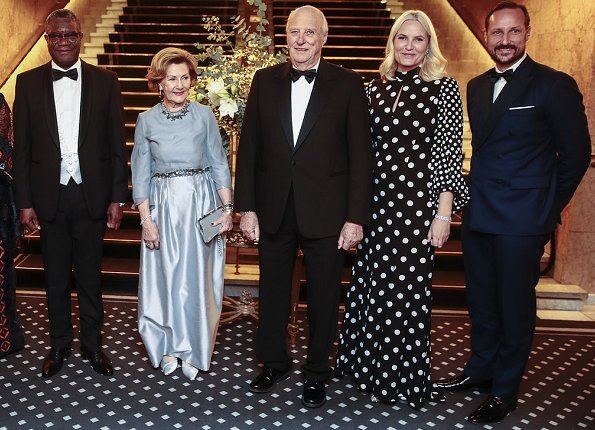 Crown Princess Mette-Marit wore Andrew Gn High-neck polka-dot print balloon-sleeve silk gown.  Denis Mukwege and Nadia Murad