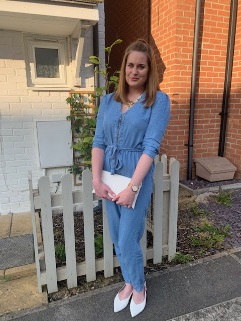 Girl wearing a jumpsuit outside a house